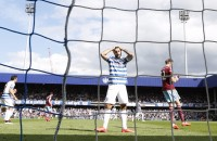 """Queens Park Rangers' English striker Charlie Austin (C) reacts after missing his penalty during the English Premier League football match between Queens Park Rangers and West Ham at Loftus Road Stadium in London on April 25, 2015. AFP PHOTO / IAN KINGTONRESTRICTED TO EDITORIAL USE. No use with unauthorized audio, video, data, fixture lists, club/league logos or """"live"""" services. Online in-match use limited to 45 images, no video emulation. No use in betting, games or single club/league/player publications."""