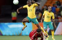 2013-11-19 00:59:06 epa03957101 South Africa's Tokelo Rantie (L) in action against Spain's Xabi Alonso (bottom) during the international friendly soccer match between South Africa and Spain at Soccer City in Soweto, South Africa, 19 November 2013.  EPA/KIM LUDBROOK
