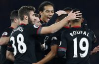 2016-11-30 20:57:33 Southampton's Dutch defender Virgil van Dijk (C) and teammates congratulate Southampton's Dutch midfielder Jordy Clasie after Clasie scored his team's first goal during the EFL (English Football League) Cup quarter-final football match between Arsenal and Southampton at the Emirates Stadium in London on November 30, 2016.  / AFP PHOTO / Adrian DENNIS / RESTRICTED TO EDITORIAL USE. No use with unauthorized audio, video, data, fixture lists, club/league logos or 'live' services. Online in-match use limited to 75 images, no video emulation. No use in betting, games or single club/league/player publications.  /