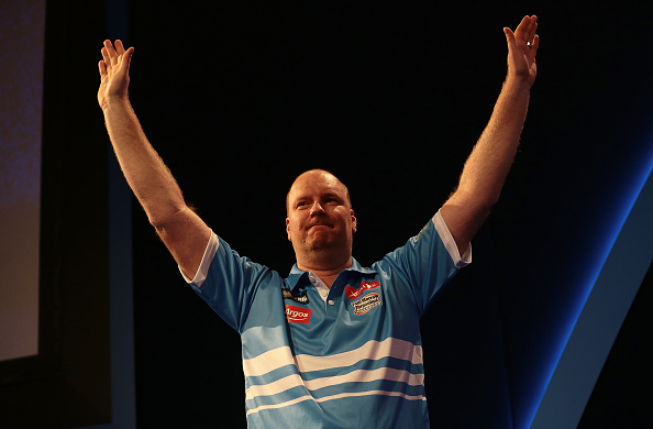 29.12.2015. Alexandra Palace, London, England. William Hill PDC World Darts Championship. Vincent van der Voort waves at the crowd as he enters the stage (Photo by Mark Kerton/ActionPlus/Corbis via Getty Images)