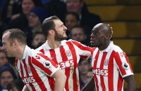 LONDON, ENGLAND - DECEMBER 31:  Bruno Martins Indi (R) of Stoke City celebrates scoring his team's first goal with his team mates Charlie Adam (L) and Erik Pieters (C) during the Premier League match between Chelsea and Stoke City at Stamford Bridge on December 31, 2016 in London, England.  (Photo by Ian Walton/Getty Images)