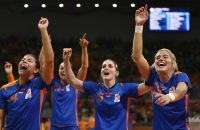RIO DE JANEIRO, BRAZIL - AUGUST 16:  Estavana Polman of Netherlands celebrates with her team mates after winning the Womens Quarterfinal match between Brazil and Netherlands on Day 11 of the Rio 2016 Olympic Games at the Future Arena  on August 16, 2016 in Rio de Janeiro, Brazil.  (Photo by Lars Baron/Getty Images)
