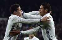 2017-01-04 21:45:14 Real Madrid's French defender Raphael Varane (R) celebrates with Real Madrid's Colombian midfielder James Rodriguez after scoring during the Spanish Copa del Rey (King's Cup) round of 16 first leg football match Real Madrid CF vs Sevilla FC at the Santiago Bernabeu stadium in Madrid on January 4, 2017. / AFP PHOTO / GERARD JULIEN