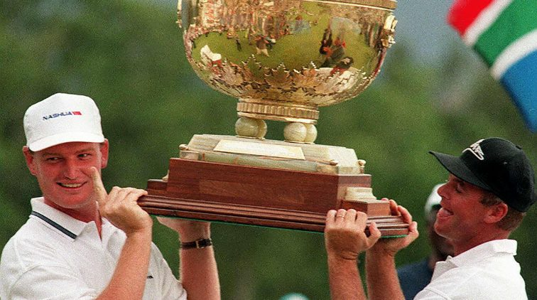 1996-11-24 00:00:00 (FILES) In this file picture taken on November 24, 1996 South African golfers Ernie Els (L) and Wayne Westner smile as they hold aloft the 1996 World Cup for golf at Erinvale, Somerset West, outside  Cape Town. Former South African golf pro Wayne Westner, who won the South African Open in 1988 and 1991, died on January 4, 2016, committing suicide when he shot himself in front of his wife, police said. Westner, 55, who also won the 1996 World Cup of Golf with compatriot Ernie Els, retired after being injured in 1998. / AFP PHOTO / ANNA ZIEMINSKI
