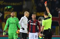 2017-02-08 21:23:11 AC Milan's defender from Italy Gabriel Paletta (2L) is shown a red card by Italian referee Daniele Doveri during the Italian Serie A football match Bologna vs AC Milan at the Stadio Renato Dall'Ara stadium in Bologna on February 8, 2017. / AFP PHOTO / GIUSEPPE CACACE