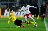 DORTMUND, GERMANY - FEBRUARY 04: Julian Weigl of Borussia Dortmund and Naby Keita of RB Leipzig battle for the ball during the Bundesliga soccer match between Borussia Dortmund and RB Leipzig at the Signal Iduna Park in Dortmund, Germany on February 4, 2017. (Photo by TF-Images/Getty Images)