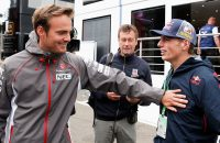 SPA, BELGIUM - AUGUST 21:  Max Verstappen, who is set to replace Jean-Eric Vergne of France at Scuderia Toro Rosso next season, speaks with test driver Giedo van der Garde of Netherlands and Sauber F1 through the paddock during previews ahead of the Belgian Grand Prix at Circuit de Spa-Francorchamps on August 21, 2014 in Spa, Belgium.  (Photo by Dean Mouhtaropoulos/Getty Images)