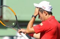 Kei Nishikori, of Japan, rubs his head as he walks on his side of the court during a game against Fabio Fognini, of Italy, at the Miami Open tennis tournament, Wednesday, March 29, 2017, in Key Biscayne, Fla. Fognini won 6-4, 6-2. (AP Photo/Luis M. Alvarez)