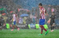 Atletico Madrid's Montenegrin defender Stefan Savic walks on the pitch under heavy rain at the end of the UEFA Champions League semi final second leg football match Club Atletico de Madrid vs Real Madrid CF at the Vicente Calderon stadium in Madrid, on May 10, 2017. Real Madrid secured their place in the Champions League final on today despite losing 2-1 away to Atletico Madrid in their semi-final second leg. / AFP PHOTO / JAVIER SORIANO